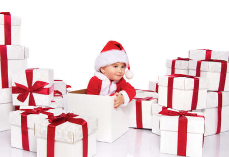Baby boy in Santa Claus costume sitting inside gift box Stock Photo - 11232020