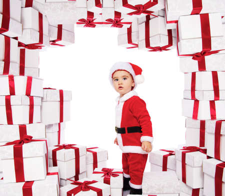 Baby boy in Santa Claus costume standing photo