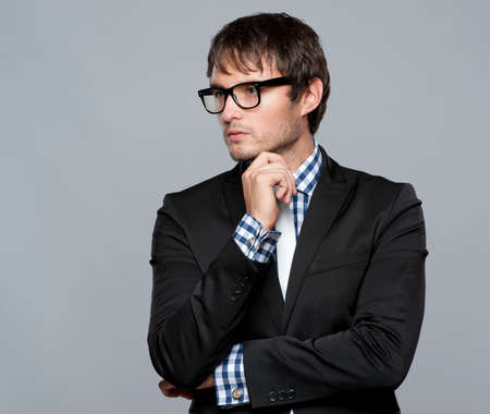 Handsome young man in glasses photo