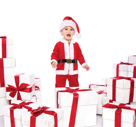 Displeased baby boy in Santa Claus costume  photo