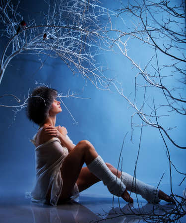 warmers: Attractive woman in winter forest