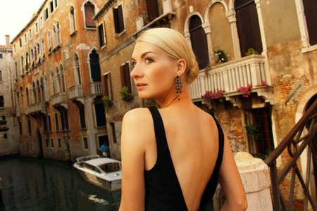 jewelry model: Blond lady on a bridge. Stock Photo