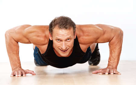 athletic body: Handsome muscular man doing push-up Stock Photo