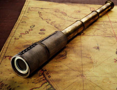 telescope: Close-up of a spyglass on the old map Stock Photo