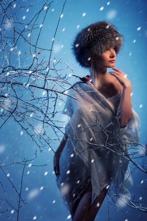 blizzard: Attractive woman in winter forest