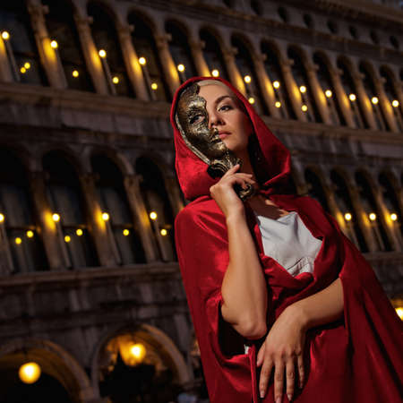 venice carnival: Beautiful woman with a mask outdoor Stock Photo