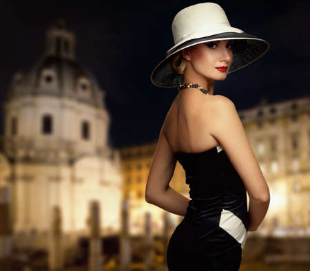 vintage woman: Retro woman against night city. Stock Photo