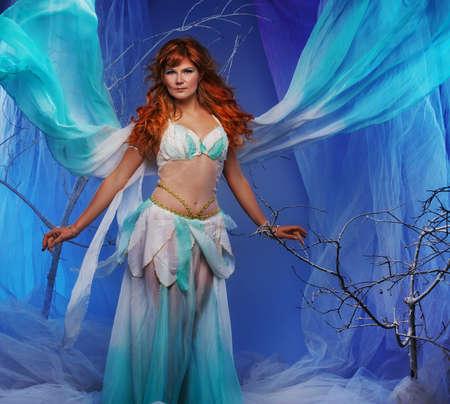 elfin: Elf in magical winter forest. Stock Photo