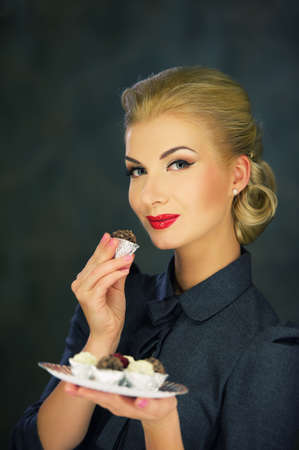 retro woman: Retro woman with sweets. Stock Photo