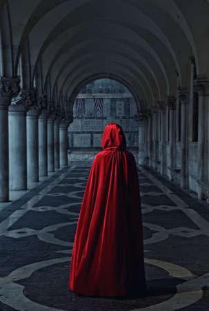 cloak: Woman in red cloak walking away