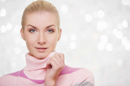 Beautiful woman in cashmere sweater portrait. photo