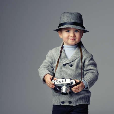 retro camera: Baby boy with retro camera.