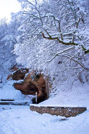 sigulda: Cave in beautiful winter landscape.
