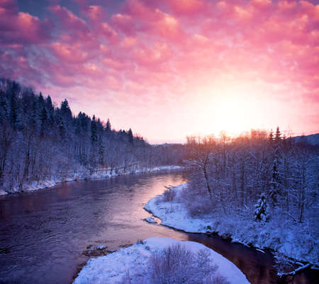 Beautiful river in  winter landscape. photo