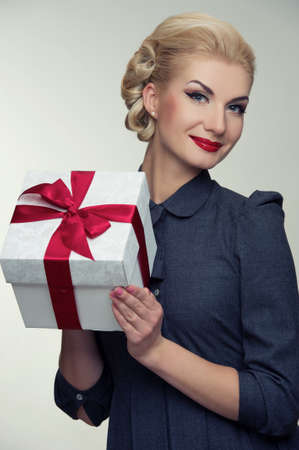 Retro woman with a gift box. photo