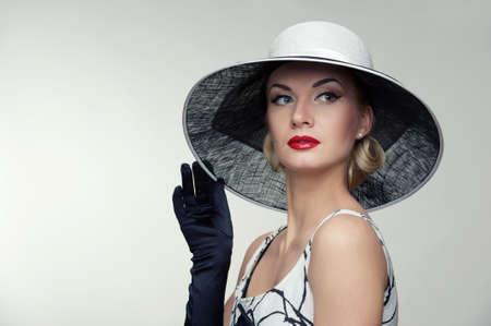 Woman in hat retro portrait. photo