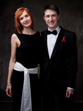 dress suit: Beautiful young couple. Stock Photo