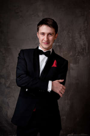 formal clothes: Young man wearing tuxedo. Stock Photo