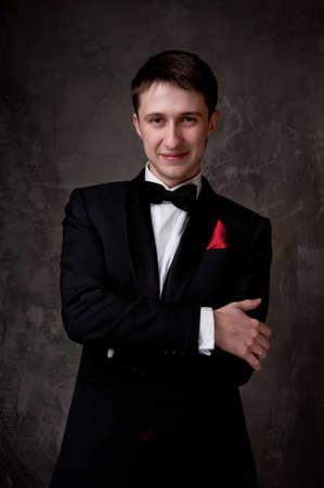 Young man wearing tuxedo. photo