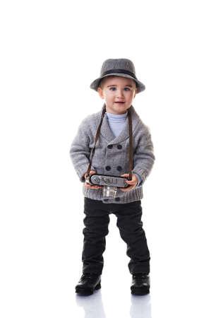 Baby boy with retro camera. photo
