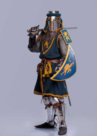 Medieval knight isolated on grey background. photo