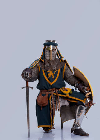 chain armour: Medieval knight standing on his knee.