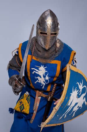 Medieval knight on grey background. photo