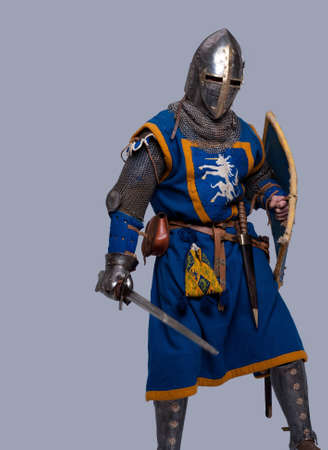 chain armour: Medieval knight on grey background.