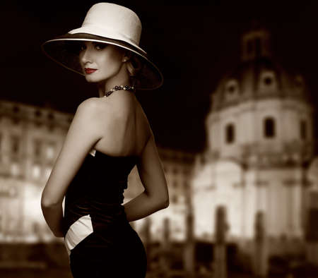 Retro woman against night city. photo