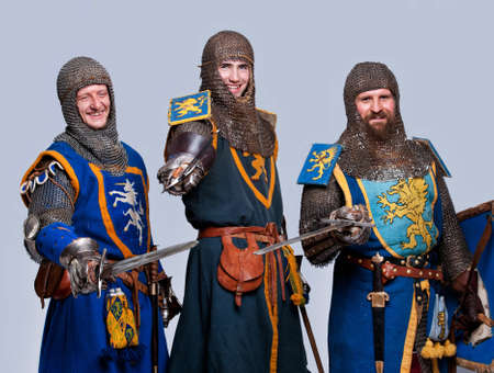 Three medieval knights isolated on grey background. Stock Photo - 12148930