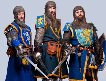 Three medieval knights isolated on grey background. Stock Photo - 12148905