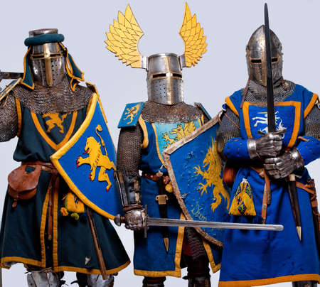 Three medieval knights isolated on grey background. Stock Photo - 12148924