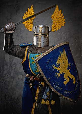 chain armour: Medieval knight in attack position.