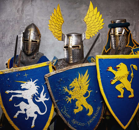 Three medieval knights  on grey background. photo
