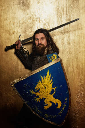 hauberk: Medieval knight on golden background. Stock Photo
