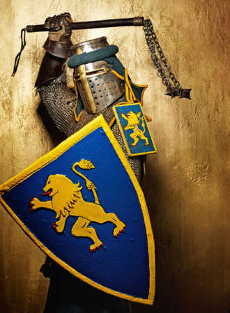 Medieval knight on golden background. Stock Photo - 12148915