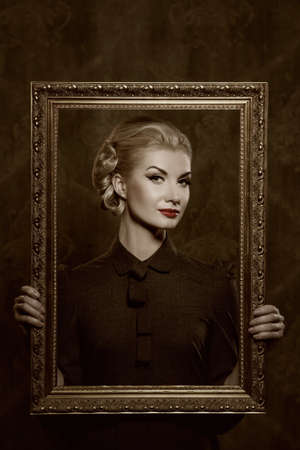 Retro woman with picture frame. photo