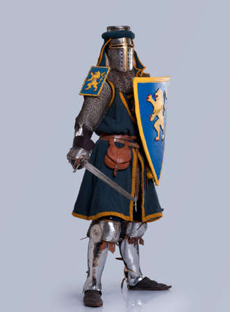 blue grey coat: Medieval knight isolated on grey background.