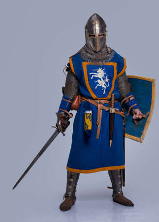 hauberk: Medieval knight on grey background.