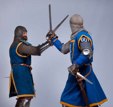 hauberk: Two medieval knights fighting.