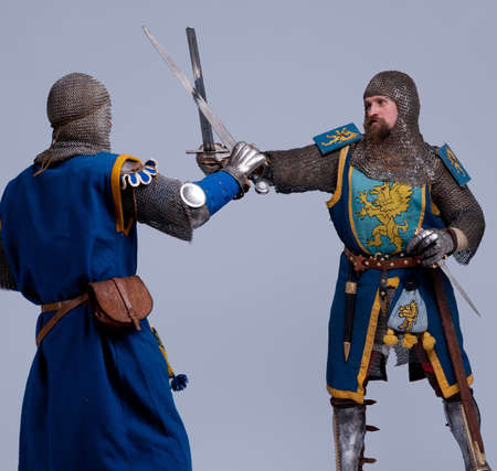 Two medieval knights fighting. photo