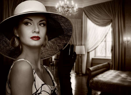 Beautiful woman in hat in luxury room. Stock Photo - 12148898
