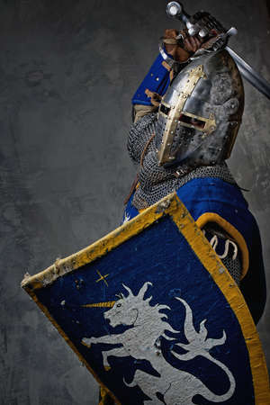 Medieval knight in attack position. Stock Photo - 12221644