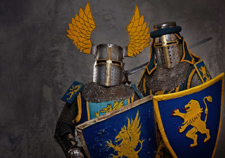 Medieval knights on grey background. photo