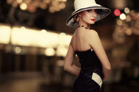 Woman in hat over blurred background.  photo