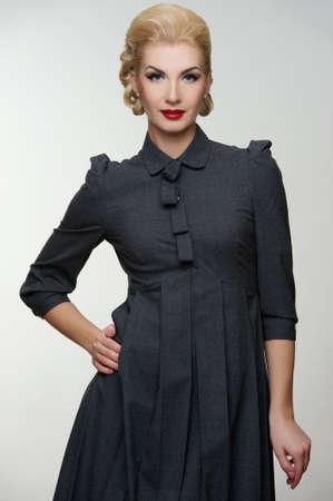 Retro woman in grey dress. Stock Photo - 12221656
