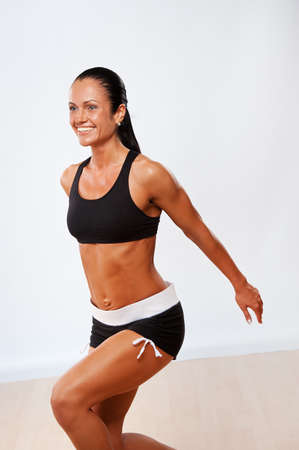 vertical wellness: Beautiful athlete woman doing fitness exercise.