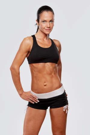 Beautiful athlete woman doing fitness exercise. photo