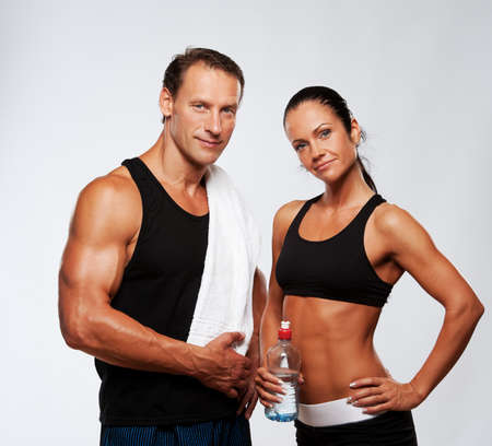 tummy: Athletic man and woman after fitness exercise