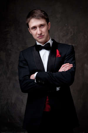 formal wear: Young man wearing tuxedo. Stock Photo